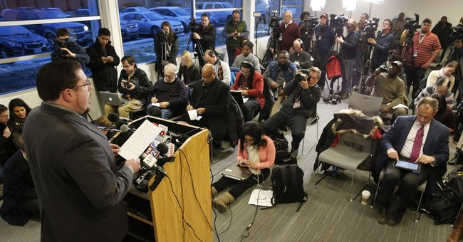 Ferguson police chief stays on the job after federal report