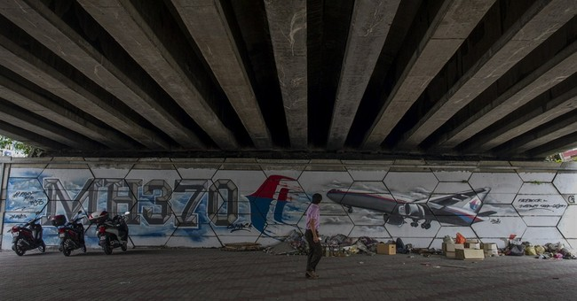 Kin mark MH370 anniversary with vow to never give up