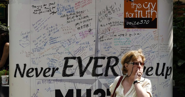 Vowing never to give up, relatives mark MH370 anniversary