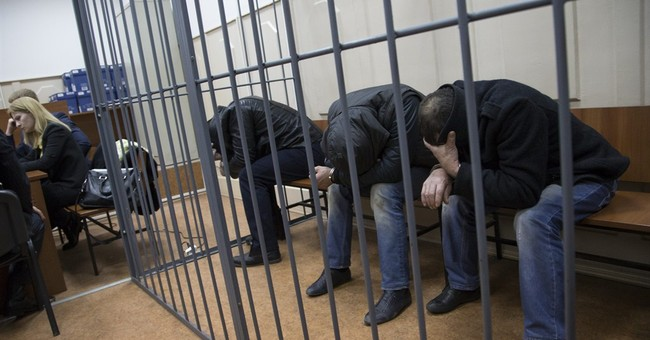 Russian court charges 2, detains 3 others in Nemtsov killing