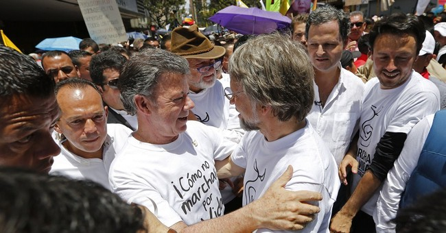 Colombia's president suspends air attacks on FARC camps