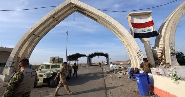 Iraqis living under IS rule fear liberation means reprisals