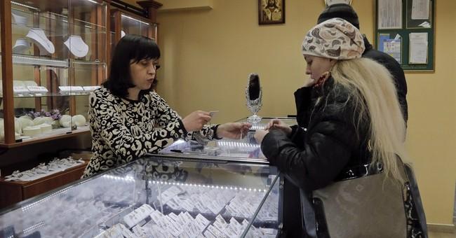 Ukraine industry seeks ties with West, but buckles in crisis