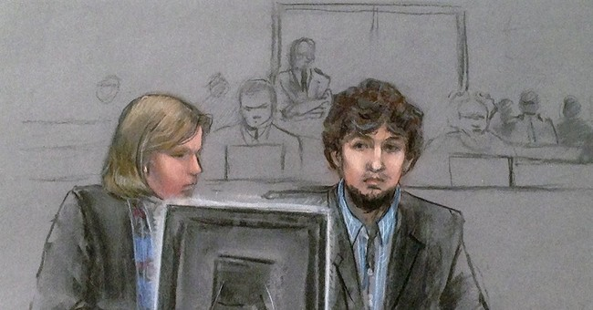 Woman now in wheelchair testifies at Boston bombing trial