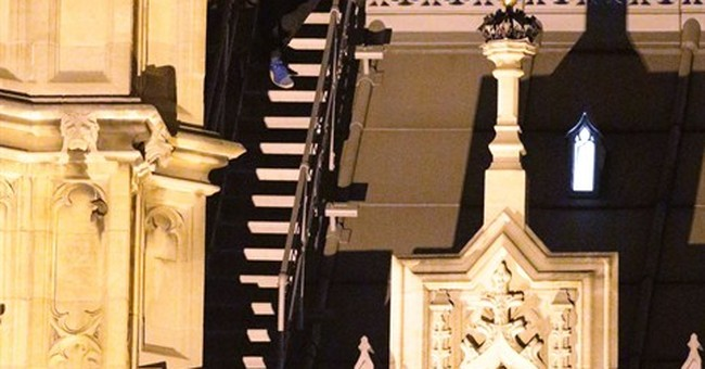 UK Parliament tightens security after man climbs on roof