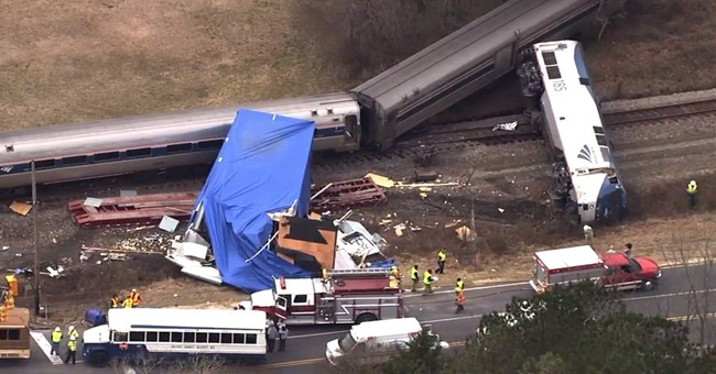 Train crashes into tractor-trailer; at least 55 hurt