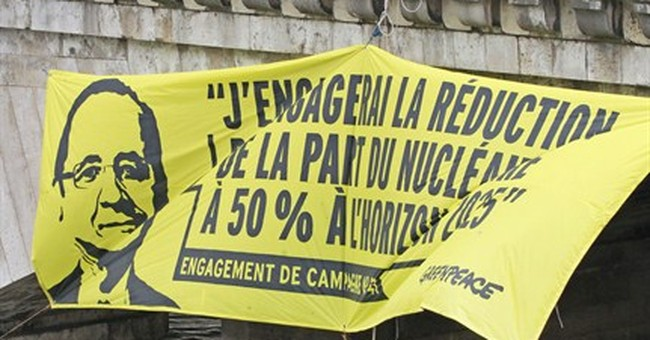 Police break up anti-nuclear protest by Greenpeace in Paris