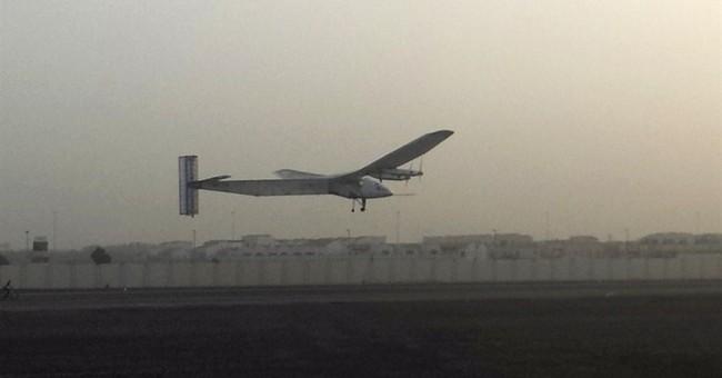Solar-power plane airborne on historic round-the-world trip