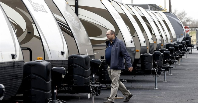 US wholesale stockpiles increase, sales sink in January