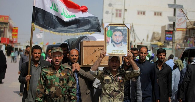 Iraq seizes town on outskirts of Islamic State-held Tikrit