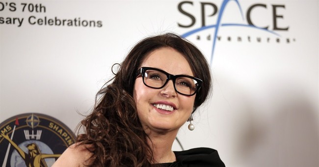 Soprano Sarah Brightman works on song to perform from space