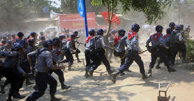 Myanmar police charge at student protesters with batons