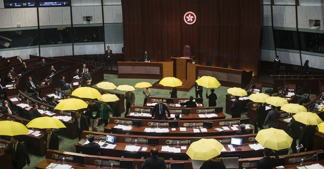 Pro-democracy lawmakers walk out of Hong Kong council