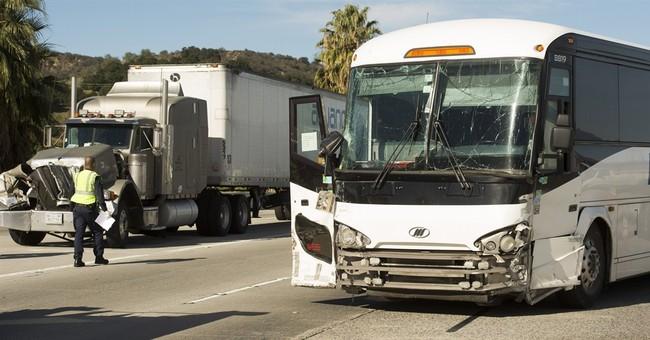 13 hurt when bus, 2 big rigs crash on California freeway