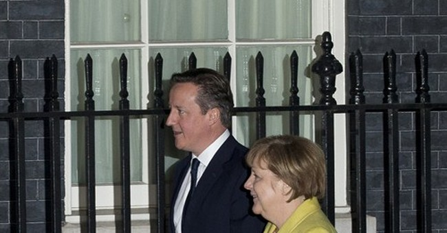 Cameron, Merkel call French leader after newspaper attack