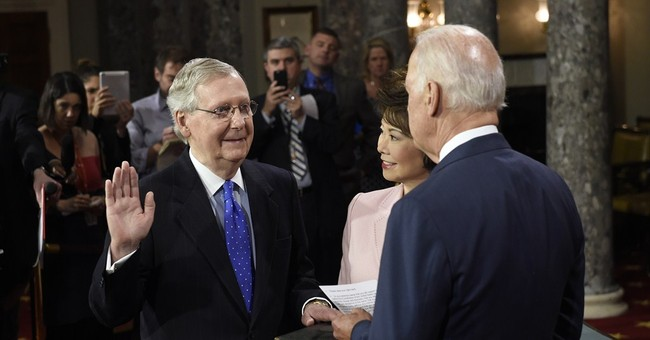 McConnell blasts veto threat, asks Obama to work with GOP