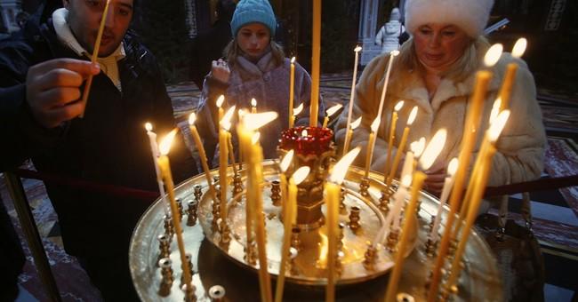 Orthodox Christians mark Christmas with prayers, Mass