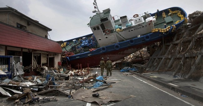 AP PHOTOS: Japan's slow tsunami recovery, 4 years on