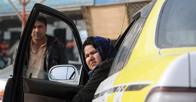 Afghanistan's only woman taxi driver steers change