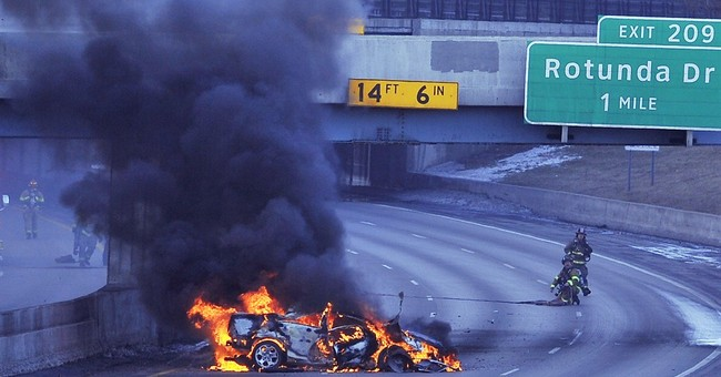 Burning tanker truck shuts down Detroit-area freeway