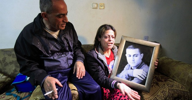 Father of Palestinian killed in Syria says son duped into IS