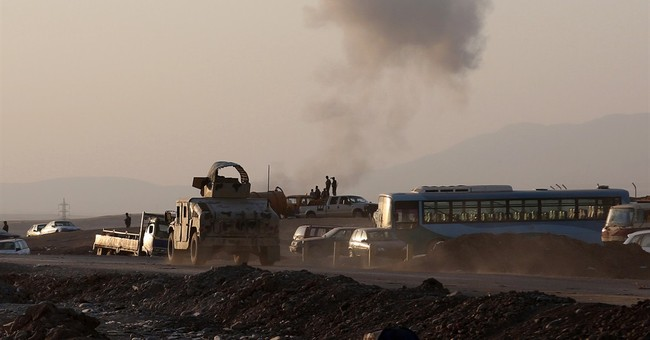 Q&A: US troop positions in Iraq keep them off front lines