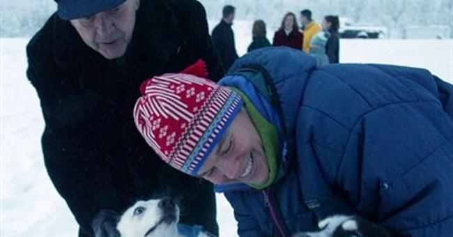 AP PHOTOS: Dogs dash across ice toward Iditarod halfway mark