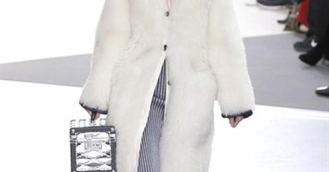 Zellweger hides face at Miu Miu in Paris; Kimye hit Vuitton