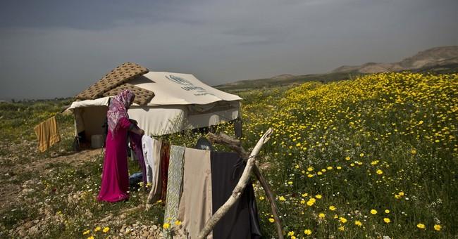 AP PHOTOS: Makeshift Jordan camps house Syrian refugees