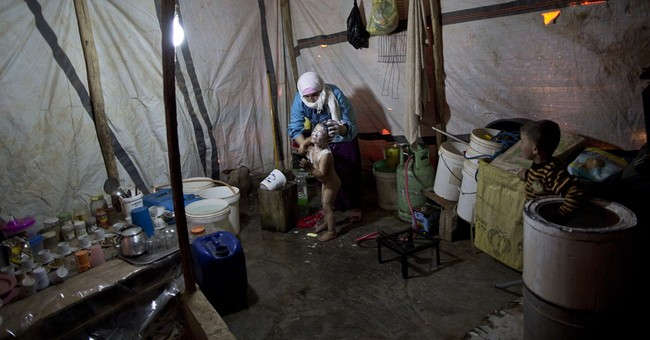 AP PHOTOS: Makeshift Jordan camps house Syrian refugees