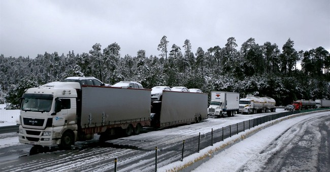 Snowstorm closes major highway into Mexico City for 8 hours