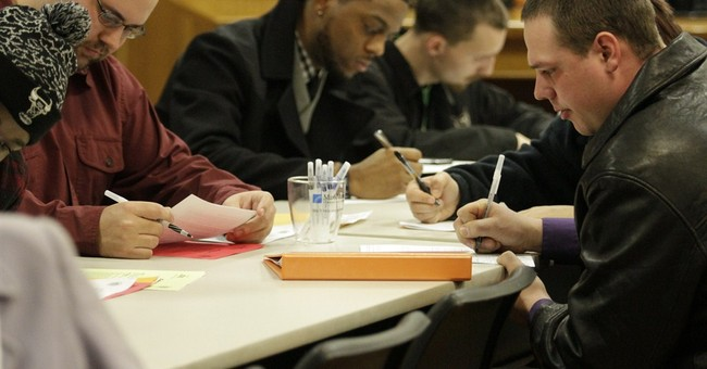 Applications for US unemployment benefits fall sharply