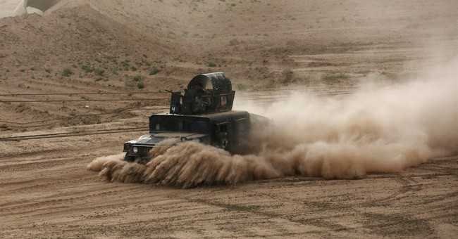 On two fronts, Iraqi forces battle Islamic State for Tikrit