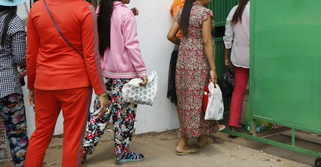 Rights group: big brands should fight Cambodian labor abuse