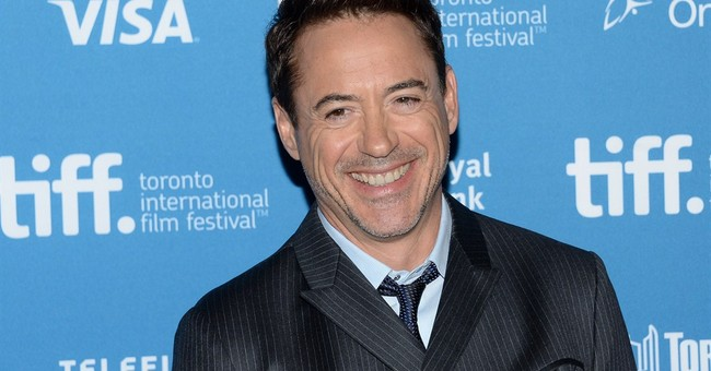 'Iron Man' star Downey presents boy with bionic arm