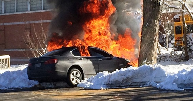 Officer pulls man from burning car, charges him with DWI