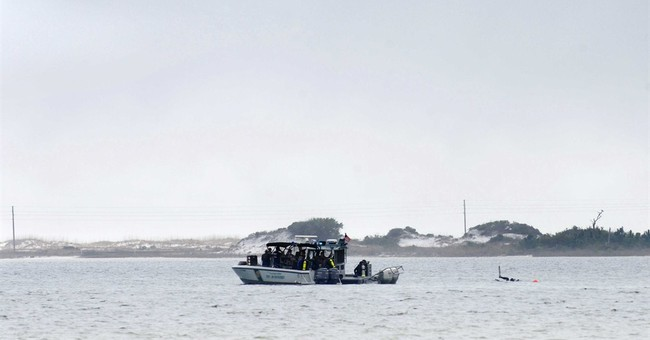 Bad weather keeps helicopter wreckage 25 feet under water
