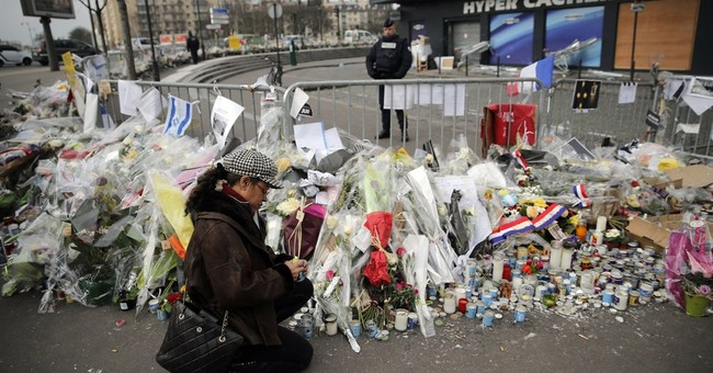 2 charged over links to Paris gunman, evidence includes DNA