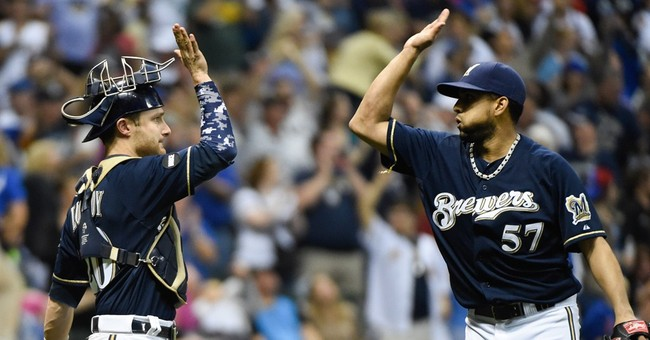Brewers ban hand-slapping high-fives because of pink eye