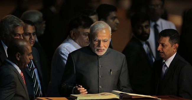 Modi woos neighbors offering 1st benefit of India's progress