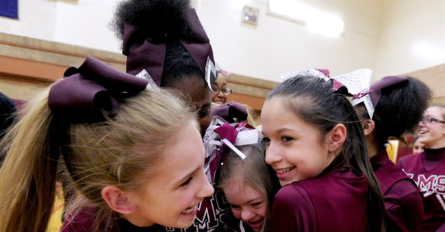 Spotlight shines on bullied cheerleader defended by athletes