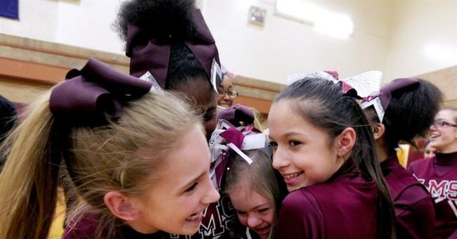 Spotlight shines on bullied cheerleader defended by athletes