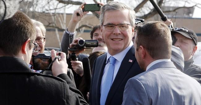 Bush tells New Hampshire he won't change views to win votes