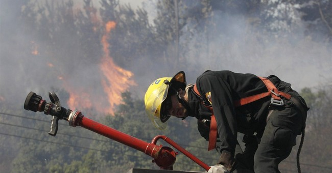 Chile wildfire reported contained; many evacuees return home