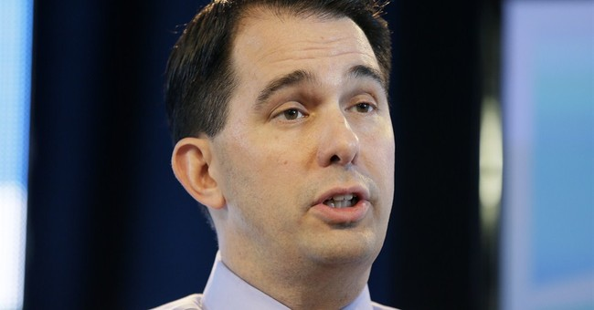Walker draws scrutiny from GOP rivals for changing positions