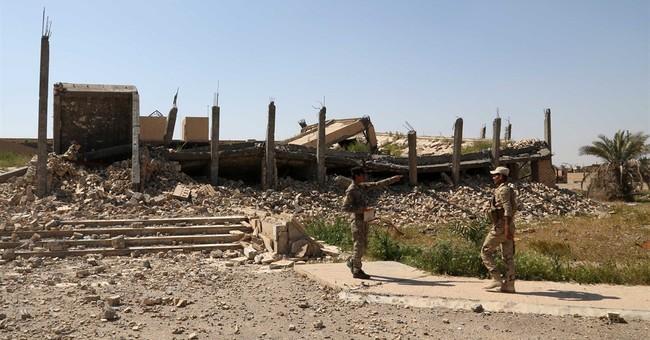 Saddam's tomb suffers extensive damage in Iraq fighting
