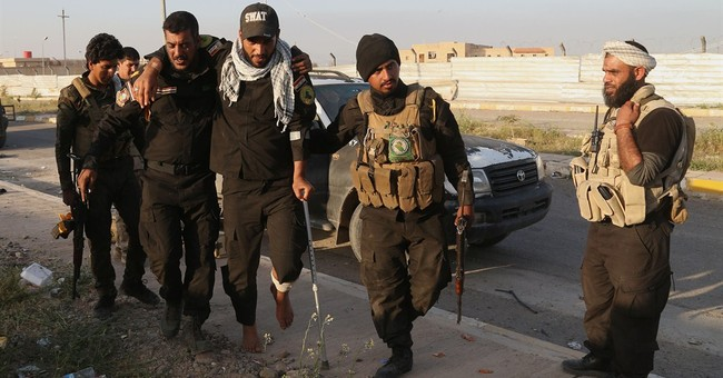 Iraqi militia loyal to radical cleric joins Tikrit offensive