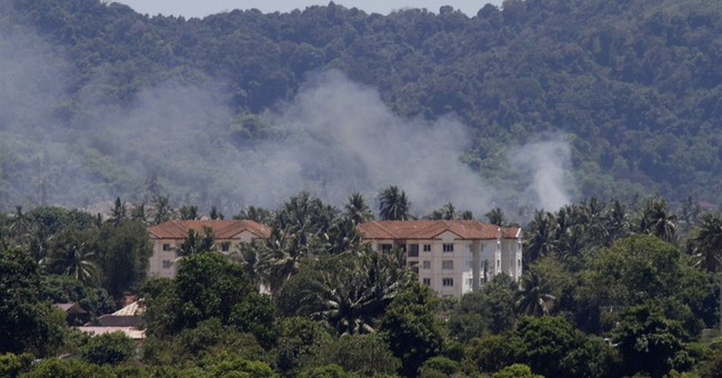 2 Indonesia planes crash at air show practice; pilots safe