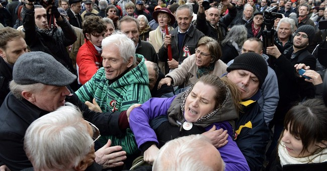 Hungarian leader's supporters jostle with protesters