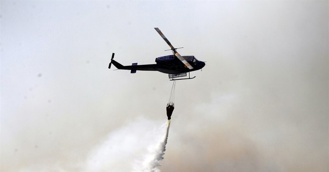 Chile firefighters contain coastal wildfire, winds persist